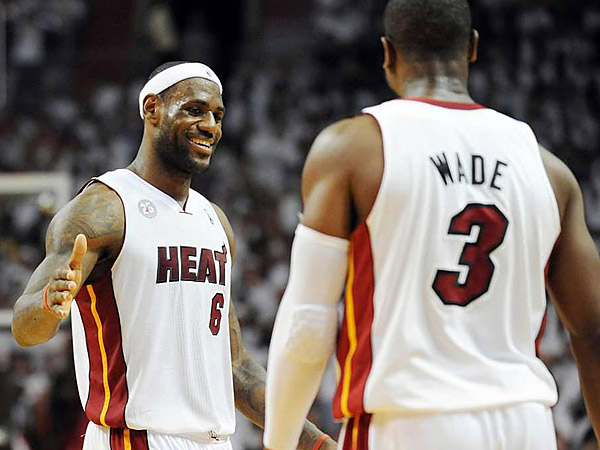 Miami´s LeBron James and Dwyane Wade. (Jim Rassol/Sun Sentinel)