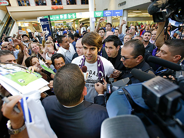 Kaka was swarmed by fans and media when he arrived in Orlando on Monday. (John Raoux/AP)