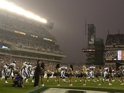 The Eagles run onto the field to cheering fans before the Linc´s inaugural game. (Ron Cortes / Staff file photo)