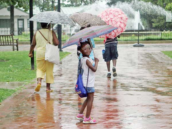 Lael Walker, 5, takes a stroll in the rain through Franklin Square in July. (STEPHANIE AARONSON / STAFF PHOTOGRAPHER)