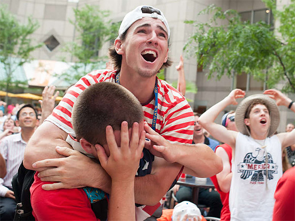 Fans react to a missed scoring opportunity for Team USA while watching the World Cup match against Belgium at Commerce Square. Some were longtime soccer fans; others were newcomers. And still others just like a party. (Matthew Hall/Staff Photographer)