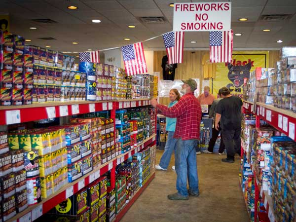Consumers browse fireworks for sale in advance of Independence Day. More people have been setting off their own fireworks in recent years, but the days surrounding the Fourth of July can result in a spike in eye and other injuries due to improper use. (AP photo)