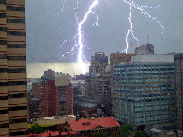 "A lightning bolt streaks down in Center City during powerful storms Thursday, July 3, 2014. (Photo by Sophia Cassidy, 12, of Poughkeepsie, N.Y., who aptly described it as an ""insane lightning bolt."")"
