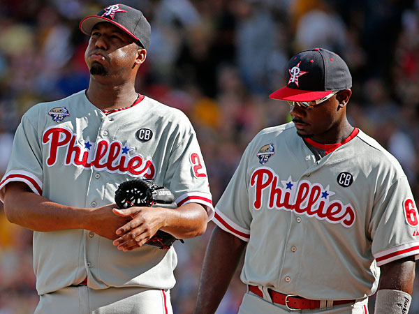 Roberto Hernandez, left, gets a visit from first baseman Ryan Howard (6) during the first inning of a baseball game against the Pittsburgh Pirates in Pittsburgh, Friday, July 4, 2014. (Gene J. Puskar/AP)