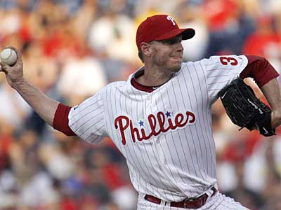 Phillies pitcher Roy Halladay pitched a complete game helping the Phillies defeat the Braves, 3-1. (AP Photo/H. Rumph Jr)