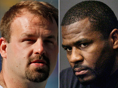 Former Eagles Jon Runyan, left, and Jeremiah Trotter tangled at training camp in 2000. (Associated Press)