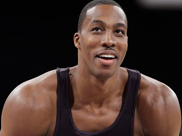 Dwight Howard seems comfortable watching everyone dance for him. (AP Photo/Jae C. Hong)
