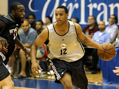 Evan Turner scored 12 points in his summer league debut, and the Sixers beat the Nets, 84-74. (AP Photo / John Raoux)