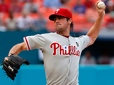 Cole Hamels held the Marlins to two runs on seven hits and one walk with five strikeouts in eight innings. (Wilfredo Lee/AP)