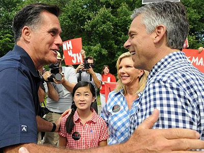 Mitt Romney greets rival Jon Huntsman, wife Mary Kaye Huntsman and daughter Gracie Mei before a July 4 parade in Amherst, N.H.