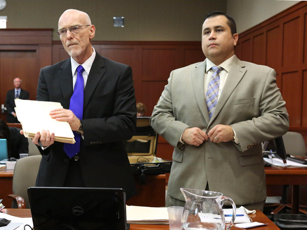 George Zimmerman, right, stands next to one of his defense attorneys, Don West, during his trial in Seminole circuit court, Friday, July 5, 2013, in Sanford, Fla.