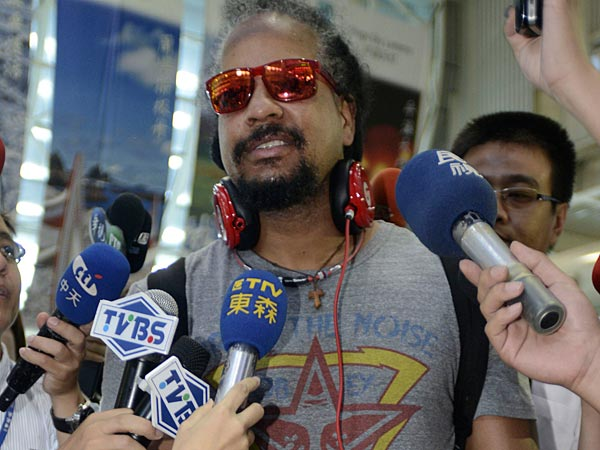 Slugger Manny Ramirez talks to media at the airport in Kaohsiung, Taiwan, Friday, June 21, 2013, before departing to the United States. Ramirez is leaving Taiwan after playing for the Rhinos for three months, saying he will work out in the United States and hopes to play again in the major leagues. Ramirez also said he would consider offers to play in Japan. (AP Photo)
