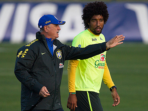 Brazil coach Luiz Felipe Scolari gives instructions to his player Dante. (Leo Correa/AP)