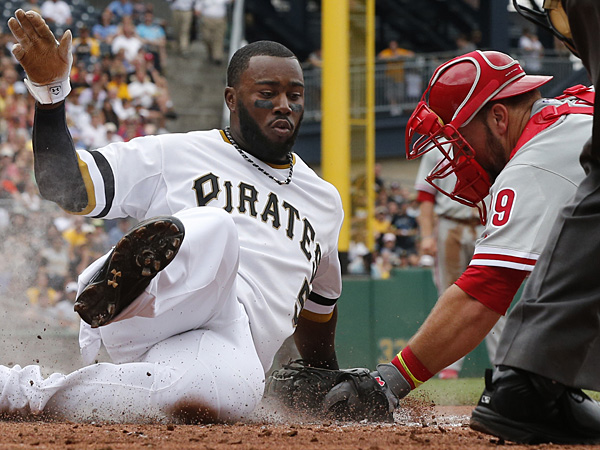 Josh Harrison scores ahead of the tag by Phillies catcher Cameron Rupp during the third inning in Pittsburgh on Sunday, July 6, 2014. (Gene J. Puskar/AP)