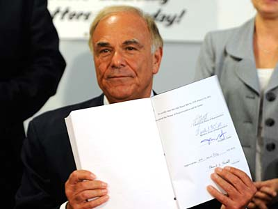 Pennsylvania Gov. Ed Rendell displays the state budget document he has just signed at the Elmwood Elementary School on Tuesday. (AP Photo/Bradley C Bower)