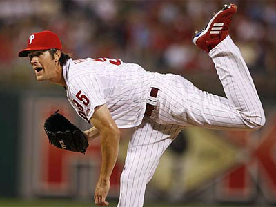 Cole Hamels delivers a pitch during the Phillies 22-1 rout of the Reds on Monday. Hamels pitched seven innings and even went 2-for-4 at the plate, with two runs scored and two RBIs. (Ron Cortes / Staff Photographer)