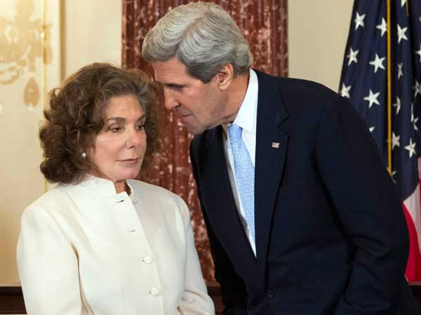 In this Wednesday, Feb. 6, 2013 file photo, Secretary of State John Kerry, right, whispers to his wife Teresa Heinz Kerry during the ceremonial swearing-in for him as the 68th secretary of state. (AP photo)