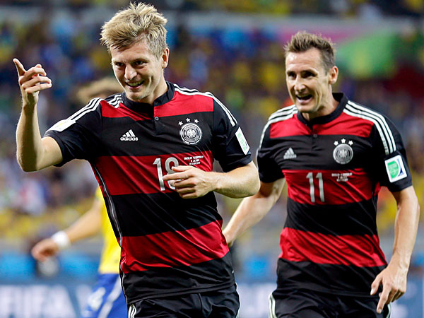 Germany´s Toni Kroos, left, celebrates with Miroslav Klose (11) after scoring his side´s fourth goal during the World Cup semifinal soccer match between Brazil and Germany at the Mineirao Stadium in Belo Horizonte, Brazil, Tuesday, July 8, 2014. (AP Photo/Natacha Pisarenko)