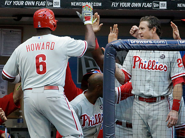 Ryan Howard (6) is congratulated after hitting a two-run home run during the ninth inning of a baseball game against the Milwaukee Brewers Thursday, July 10, 2014, in Milwaukee. (Morry Gash/AP)