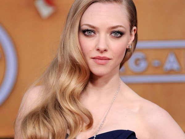 Amanda Seyfried arrives at the 19th Annual Screen Actors Guild Awards at the Shrine Auditorium in Los Angeles on Sunday Jan. 27, 2013. (Photo by Jordan Strauss/Invision/AP)