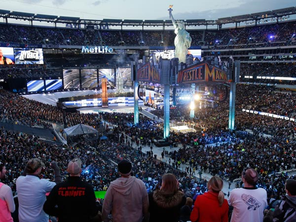 MetLife Stadium is packed with fans as they watch the WWE Wrestlemania 29 event Sunday, April 7, 2013, in East Rutherford, N.J. (Mel Evans/AP file)