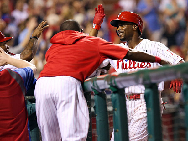 Jimmy Rollins (11) is congratulated as he walks back to the dugout after hitting a home run in the seventh inning of a game against the Washington Nationals at Citizens Bank Park. The Phillies won 6-2. (Bill Streicher/USA Today)