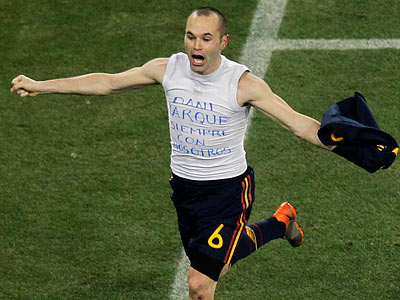 Spain´s Andres Iniesta celebrates scoring the winning goal in the World Cup final. (Hassan Ammar/AP)