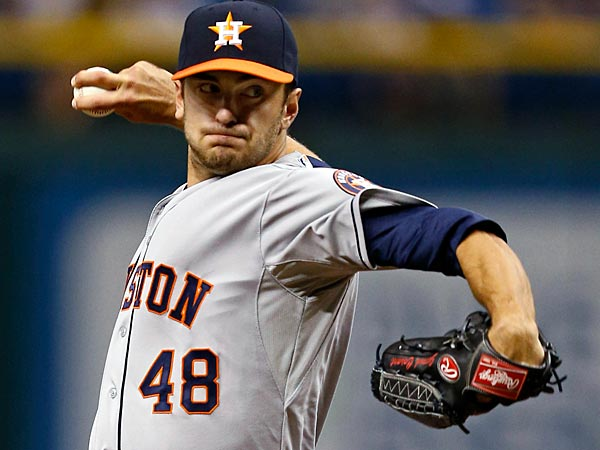 Houston Astros starting pitcher Jarred Cosart throws during the first inning of his major league debut in a baseball game against the Tampa Bay Rays, Friday, July 12, 2013, in St. Petersburg, Fla. (AP Photo/Mike Carlson)