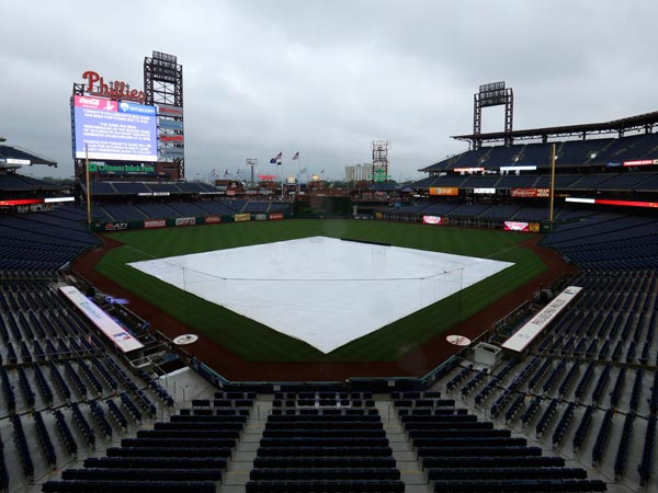 A tarp covers the field at Citizens Bank Park after a rain storm canceled an interleague baseball game between the Philadelphia Phillies and the Chicago White Sox, Friday, July 12, 2013, in Philadelphia. (Matt Slocum/AP)
