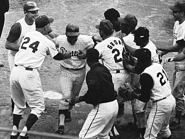 National League teammates, many of them future Hall of famers, swarm Johnny Callison after his homer in the ´64 All-Star Game. (AP)