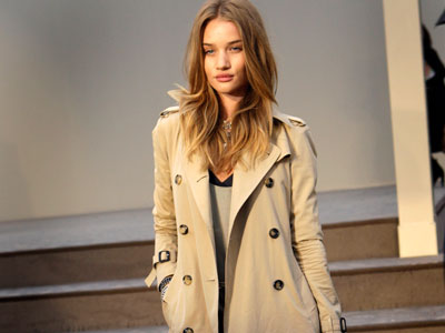 Burberry model Rosie Huntington-Whiteley in a classic trench from the brand. (AP Photo)