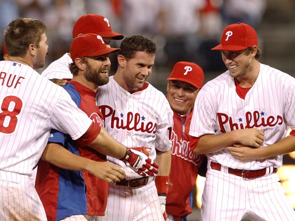 Michael Young (center) celebrate a walk-off victory over the White Sox in the second game of a doubleheader. (Ron Cortes/Staff Photographer)