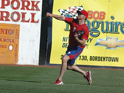 Brad Lidge long tosses before his appearance with the Reading Phillies on Thursday night. (Marc Narducci/Staff)