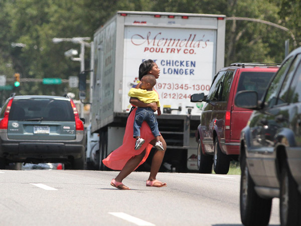 A woman runs across Roosevelt Boulevard a day after four were killed nearby.