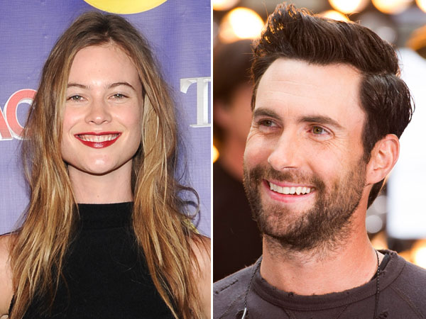 """Left, model Behati Prinsloo at the Oxygen Network´s """"The Face"""" premiere party in New York. Adam Levine´s representative confirmed Tuesday that the Maroon 5 singer is engaged to model Behati Prinsloo. The couple started dating last year. The 34-year-old singer proposed to 24-year-old Prinsloo in Los Angeles this weekend.  (Photo by Evan Agostini/Invision/AP, File)"""