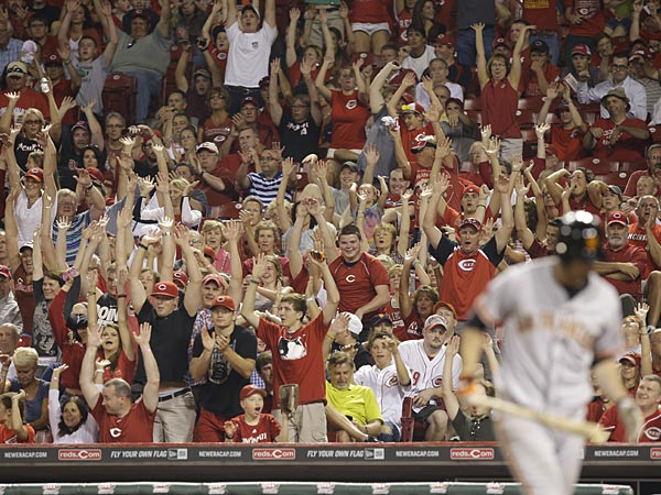 Fans do the wave at a Cincinnati Reds game in June. (Al Behrman/AP)
