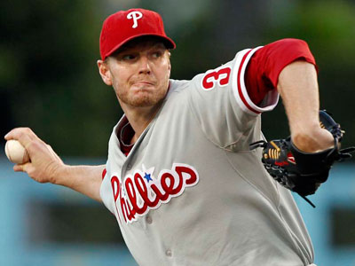 Roy Halladay struck out six batters and allowed two runs on five hits in six innings against the Dodgers. (Alex Gallardo/AP)