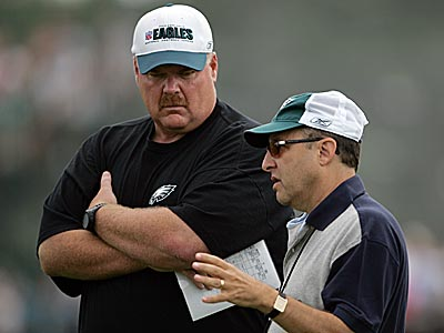 Andy Reid and Joe Banner talk during an Eagles practice. (Barbara L. Johnston / Staff Photographer)