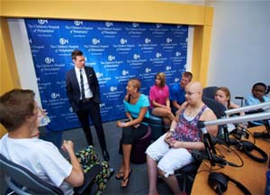 Rachel and other patients join American Idol host Ryan Seacrest for the launch of The Voice.