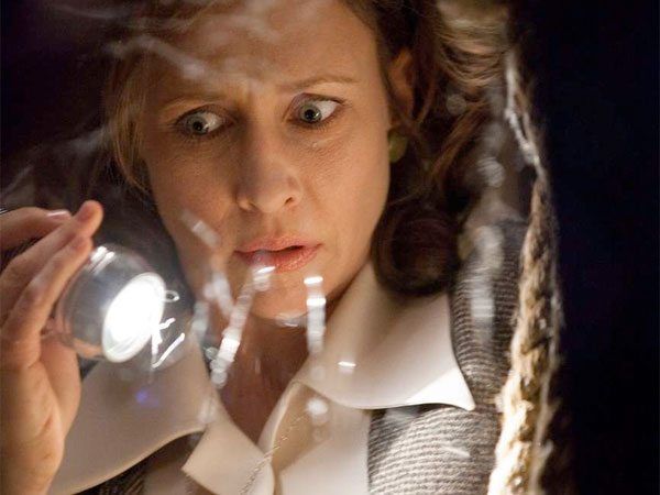 Vera Farmiga plays Lorraine Warren , a demonologist investigating paranormal activity in a Rhode Island house. MICHAEL TACKETT