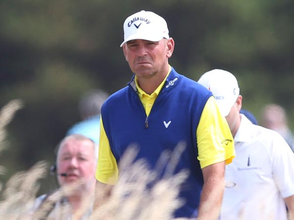 Thomas Bjorn of Denmark walks along the 8th fairway during the first round of the British Open Golf Championship at Muirfield, Scotland, Thursday July 18, 2013. (Scott Heppell/AP)