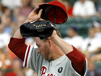 Roy Halladay wipes the sweat from his face during the first inning of Monday´s 6-1 loss to the Cubs. (AP Photo/Charles Rex Arbogast)