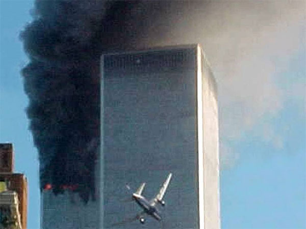 FILE- In this Sept. 11, 2001 file photo, American Airlines Flight 175 closes in on World Trade Center Tower 2 in New York, just before impact. (AP Photo / Carmen Taylor, File)