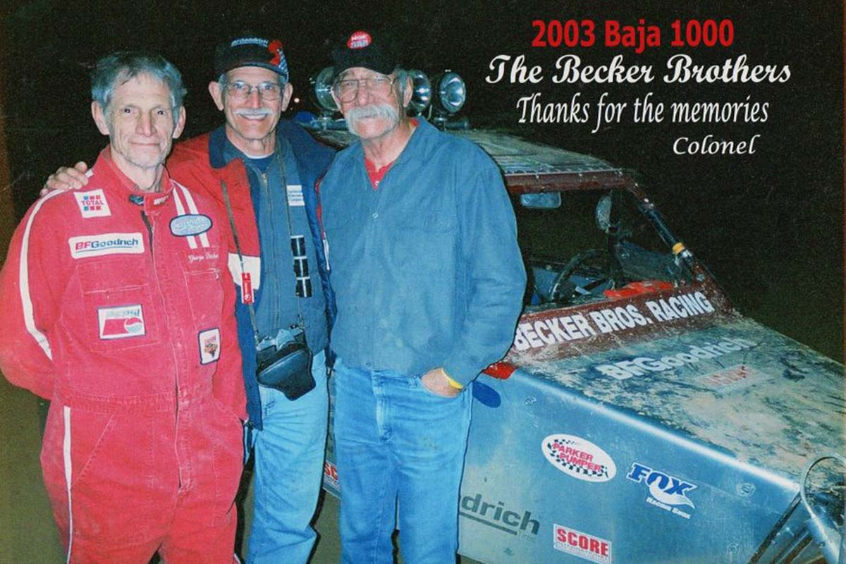 George H. Becker, center, pictured with his brothers, John D., left, and Carl. Behind them is their dune buggy entered in the 2003 Baja 1000. George Becker, who loved fixing clocks and racing, died July 12.