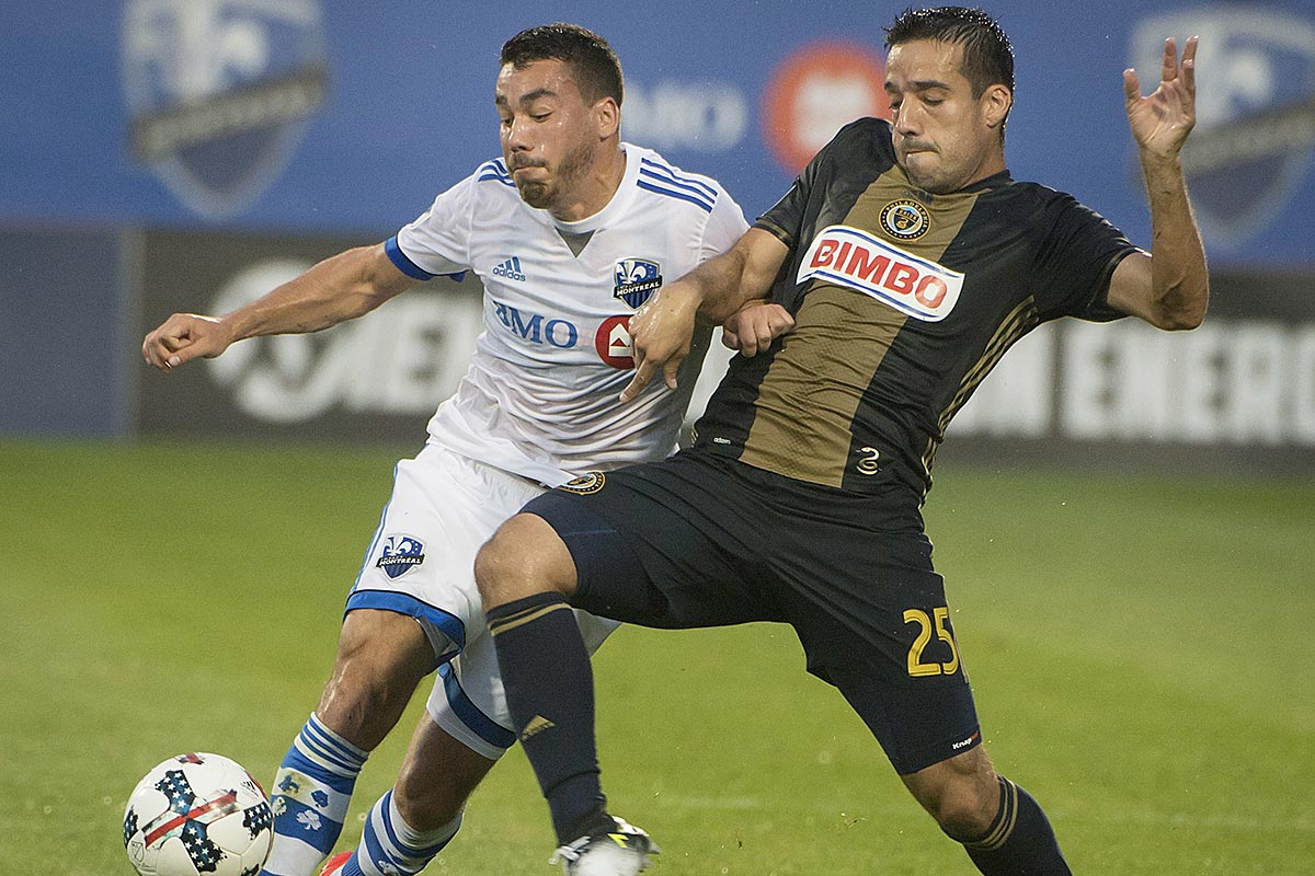 Montreal Impact´s Daniel Lovitz, left, and Philadelphia Union´s Ilsinho vie for possession of the ball during the first half of an MLS soccer match Wednesday, July 19, 2017, in Montreal.