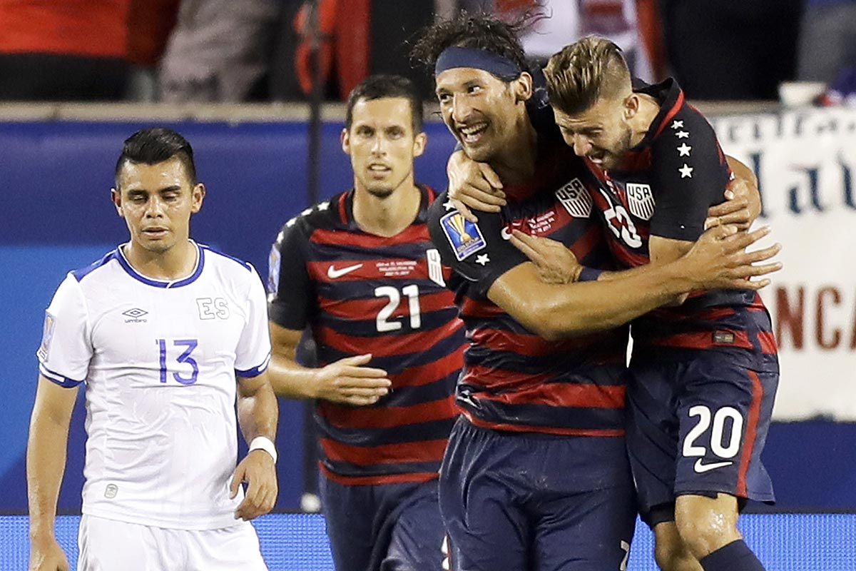 United States´ Omar González (second right) celebrates his first-half goal with teammate Paul Arriola (right), past Matt Hedges (second left) and El Salvador´s Alexander Larin.