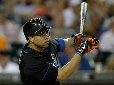 Carlos Beltran is batting .293 with 14 home runs and 59 RBI for the Mets this season. (Paul Sancya/AP)