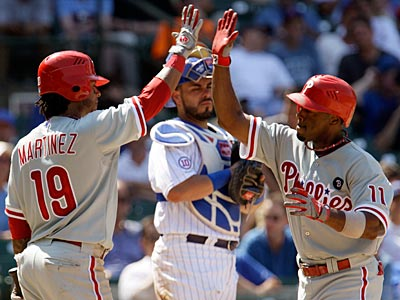 Jimmy Rollins and Michael Martinez went a combined 5-for-10 with two home runs, four RBI and six runs scored. (Nam Y. Huh/AP)