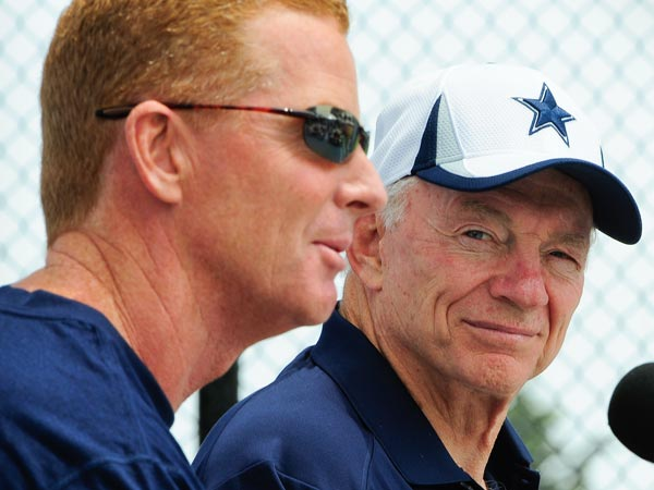 Cowboys owner Jerry Jones, right, watches as head coach Jason Garrett, left, answers a question from members of the media during the State of the Cowboys address at NFL football training camp on Saturday, July 20, 2013, in Oxnard, Calif. (AP Photo/Gus Ruelas)