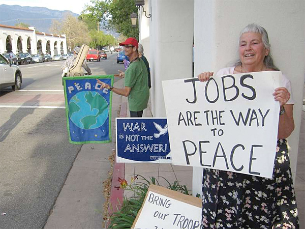 Marion Leeman and her friends have been displaying antiwar signs in downtown Ojai every Friday since 2004. (Josh Noel/Chicago Tribune)